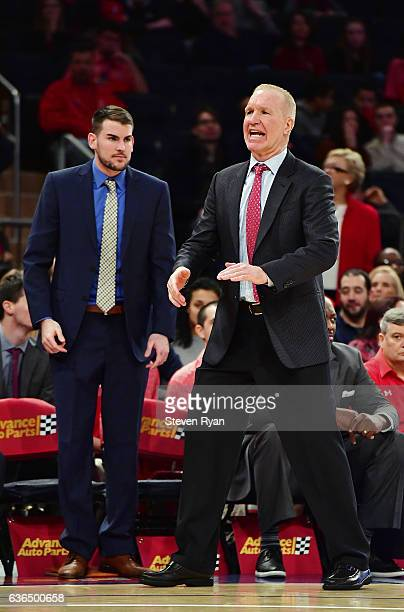 Head coach Chris Mullin and assistant coach Greg St Jean of the St JohnÕs Red Storm look on against the Penn State Nittany Lions at Madison Square...