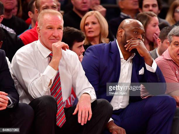 Head coach Chris Mullin and assistant coach Mitch Richmond look against the Providence Friars at Madison Square Garden on March 4 2017 in New York...