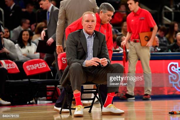 Head coach Chris Mullin of the St John's Red Storm stays seated for an extra few seconds after a timeout against the Xavier Musketeers at Madison...