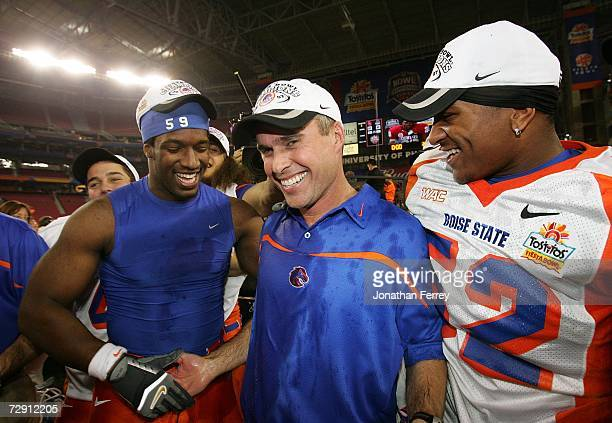 Head coach Chris Petersen of the Boise State Broncos is hugged by Will Lawrence and Derrell Acrey after defeating the Oklahoma Sooners 4342 at the...