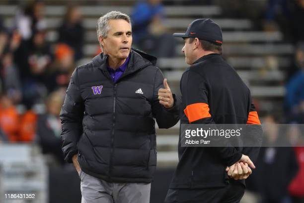 Head Coach Chris Petersen of the Washington Huskies and head coach Jonathan Smith of the Oregon State Beavers have a conversation prior to their game...