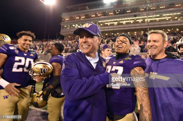Head coach Chris Petersen of the Washington Huskies celebrates with his team after defeating the Boise State Broncos 387 in the Mitsubishi Motors Las...