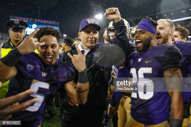 Head coach Chris Petersen of the Washington Huskies celebrates with his team after defeating the Washington State Cougars 4114 at Husky Stadium on...