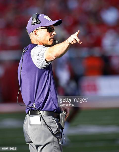 Head coach Chris Petersen of the Washington Huskies gestures to his players during the Utah Utes NCAA football game at RiceEccles Stadium on October...