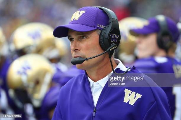 Head Coach Chris Petersen of the Washington Huskies looks on against the Hawaii Rainbow Warriors in the second quarter during their game at Husky...