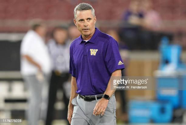 Head coach Chris Petersen of the Washington Huskies looks on during warm ups prior to the start of an NCAA football game against the Stanford...
