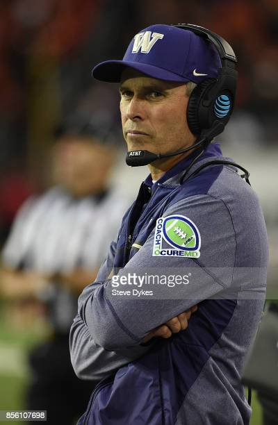 Head coach Chris Petersen # of the Washington Huskies looks on from the sidelines during the third quarter of the game against the Oregon State...