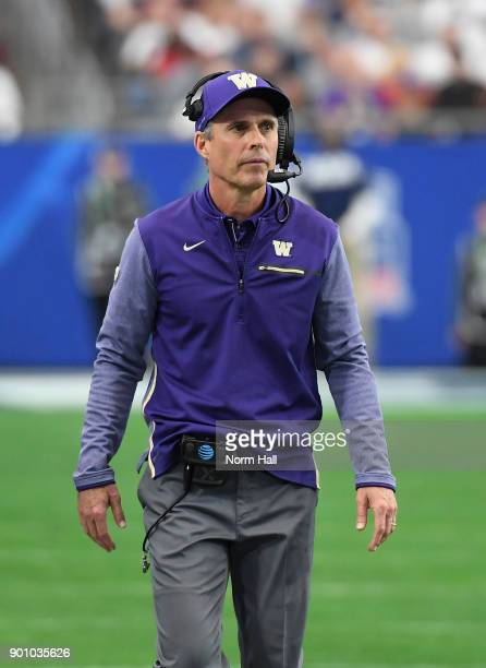 Head coach Chris Petersen of the Washington Huskies looks on from the sidelines against the Penn State Nittany Lions during the Playstation Fiesta...