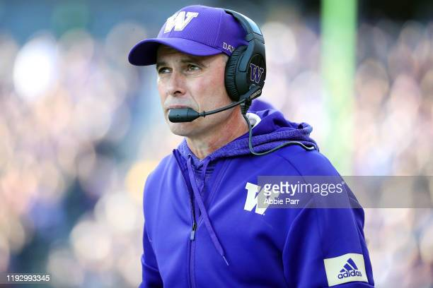 Head Coach Chris Petersen of the Washington Huskies looks on in the first quarter against the Washington State Cougars during their game at Husky...