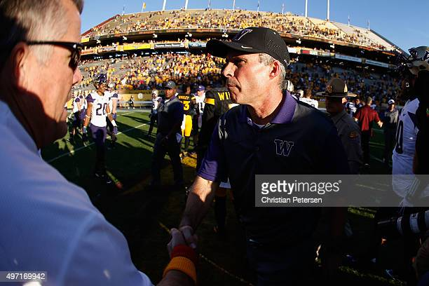 Head coach Chris Petersen of the Washington Huskies shakes hands with Todd Graham of the Arizona State Sun Devils following the college football game...