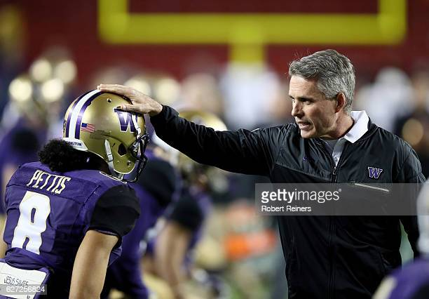 Head coach Chris Petersen of the Washington Huskies talks to Dante Pettis of the Washington Huskies before their game against the Colorado Buffaloes...