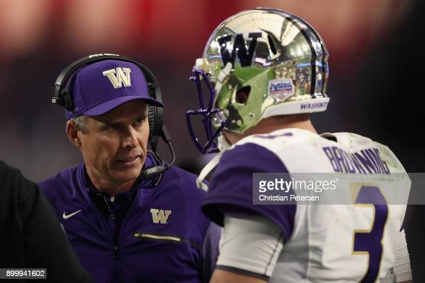 Head coach Chris Petersen of the Washington Huskies talks with quarterback Jake Browning during the second half of the Playstation Fiesta Bowl...