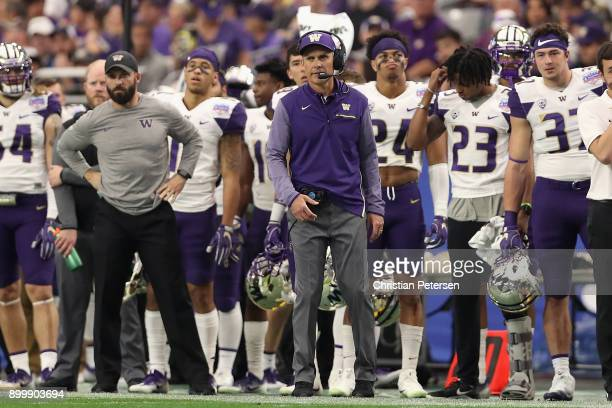Head coach Chris Petersen of the Washington Huskies walks down the sidelines during the first half of the Playstation Fiesta Bowl against the Penn...