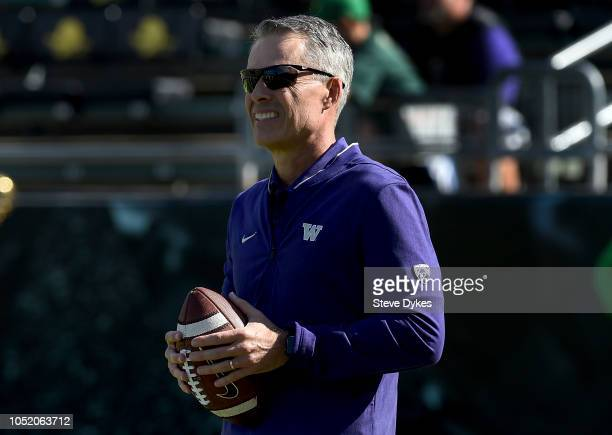 Head coach Chris Petersen warms up before the game against the Oregon Ducks at Autzen Stadium on October 13 2018 in Eugene Oregon