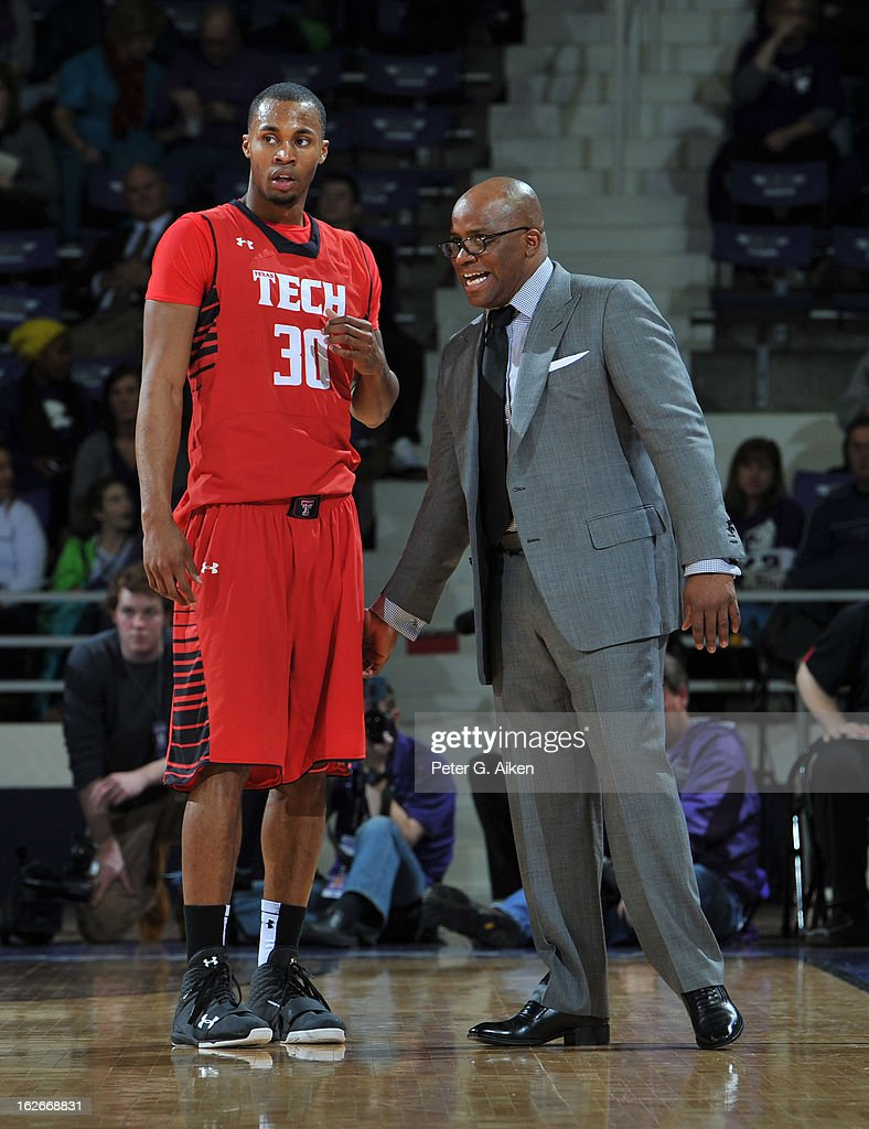 Head coach Chris Walker (R) of the Texas Tech Red Raiders talks with forward Jaye Crockett #30 against the Kansas State Wildcats during the first half on February 25, 2013 at Bramlage Coliseum in Manhattan, Kansas. Kansas State defeated Texas Tech 75-55.