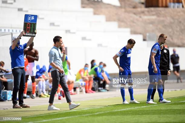 Head coach Christian Eichner of Karlsruhe reacts prior to a substitution during the Second Bundesliga match between Karlsruher SC and SV Darmstadt 98...