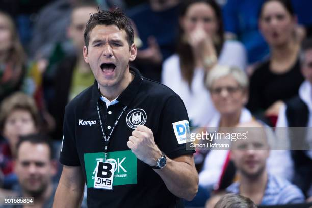 Head coach Christian Prokop of Germany celebrates during the International Handball Friendly match between Germany and Iceland at Porsche Arena on...