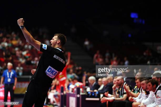 Head coach Christian Prokop of Germany celebrates during the Men's EHF EURO 2020 main round group I match between Belarus and Germany at Wiener...