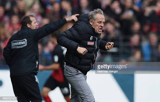 Head coach Christian Streich of Freiburg celebrates after the fourth goal for his team during the Second Bundesliga match between SC Freiburg and...