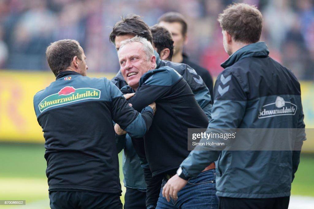 Head coach Christian Streich of Freiburg reacts during the Bundesliga match between Sport-Club Freiburg and FC Schalke 04 at Schwarzwald-Stadion on November 4, 2017 in Freiburg im Breisgau, Germany.