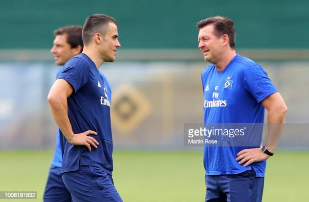 Head coach Christian Titz gives insructions to Filip Kostic during the training session of Hamburger SV at Volksparkstadion on July 31, 2018 in...