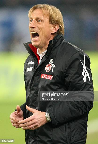 Head coach Christoph Daum of Koeln shouts at his team during the Bundesliga match between FC Schalke 04 and 1 FC Koeln at the VeltinsArena on March 6...