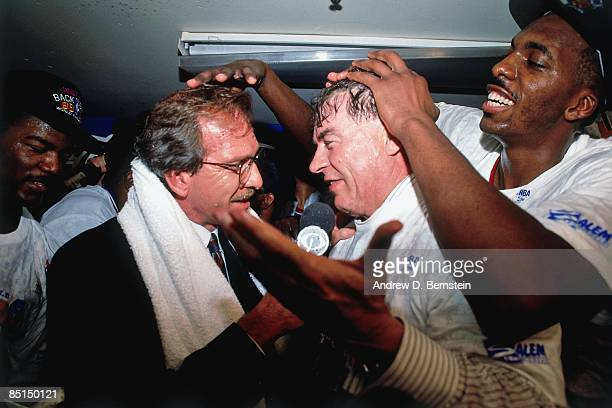 Head coach Chuck Daly of the Detroit Pistons is interviewed by Pat O'Brien as John Salley messes up his hair following Game Five of the 1990 NBA...