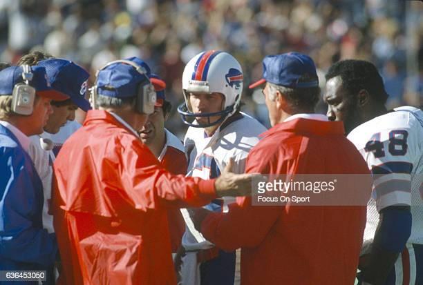 Head Coach Chuck Knox of the Buffalo Bills talks with quarterback Joe Ferguson of the sidelines during an NFL football game circa 1981 Knox was the...