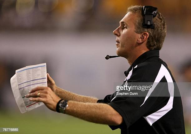 Head coach Chuck Long of the San Diego State Aztecs calls to his team in the game with the Arizona State Sun Devils on September 15 2007 at Sun Devil...