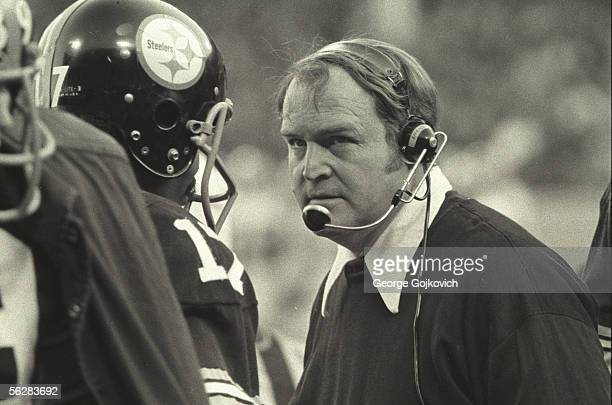Head coach Chuck Noll of the Pittsburgh Steelers talks to quarterback Joe Gilliam during a game against the Oakland Raiders at Three Rivers Stadium...