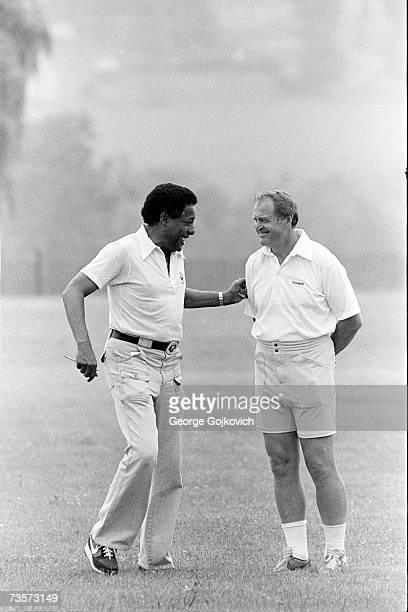Head coach Chuck Noll right of the Pittsburgh Steelers talks with Bill Nunn a member of the team's player scouting staff at summer training camp at...