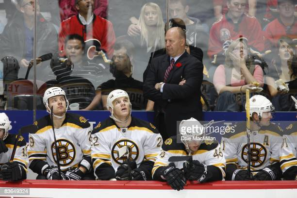 Head coach Claude Julien of the Boston Bruins looks on during the game against the Calgary Flames on October 30 2008 at the Pengrowth Saddledome in...