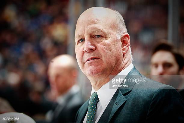 Head coach Claude Julien of the Boston Bruins looks on from the bench during their NHL game against the Vancouver Canucks at Rogers Arena December 5...