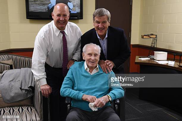 Head coach Claude Julien of the Boston Bruins meets with alumni players Bobby Orr and Milt Schmidt before the season opener against the New Jersey...
