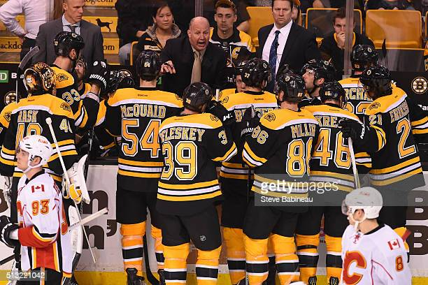 Head Coach Claude Julien of the Boston Bruins talks to this team during a time out in the third period against the Calgary Flames at the TD Garden on...