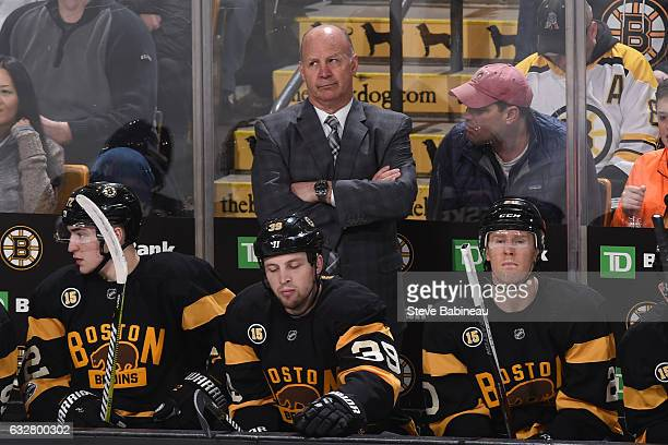 Head coach Claude Julien of the Boston Bruins watches the game against the Pittsburgh Penguins at the TD Garden on January 26 2017 in Boston...