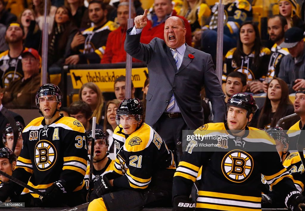 Head coach Claude Julien of the Boston Bruins yells at the referrees following a call in the third period against the Dallas Stars at TD Garden on November 5, 2013 in Boston, Massachusetts.