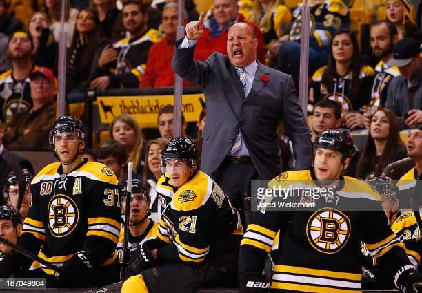 Head coach Claude Julien of the Boston Bruins yells at the referrees following a call in the third period against the Dallas Stars at TD Garden on...