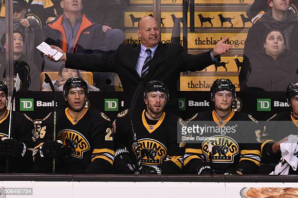 Head coach Claude Julien of the Boston Bruins yells out during a play against the Columbus Blue Jackets at the TD Garden on January 23 2016 in Boston...