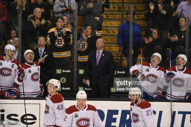 Head Coach Claude Julien of the Montreal Canadiens watches a video tribute dedicated to him during a time out against the Boston Bruins at the TD...