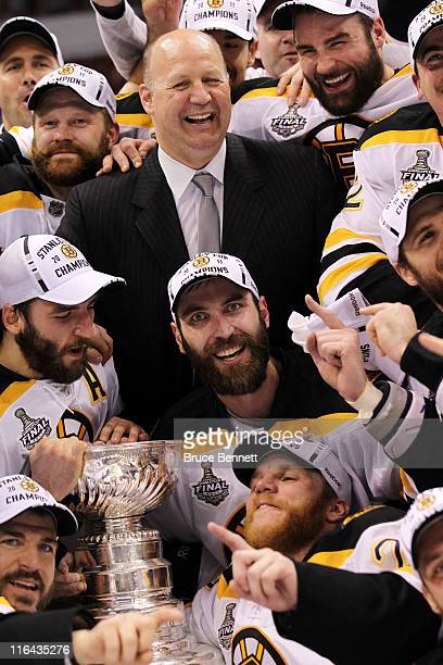 Head coach Claude Julien Tim Thomas Patrice Bergeron Mark Recchi Shawn Thornton and Zdeno Chara of the Boston Bruins pose with the Stanley Cup after...