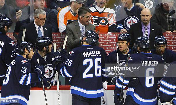 Head Coach Claude Noel of the Winnipeg Jets gives instructions to his players during a third period stoppage of play against the Philadelphia Flyers...