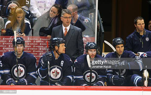 Head Coach Claude Noel of the Winnipeg Jets looks on from the bench during first period action against the Nashville Predators at the MTS Centre on...