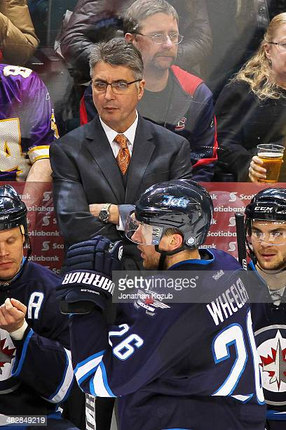 Head Coach Claude Noel of the Winnipeg Jets looks on from the bench during a third period stoppage in play against the Buffalo Sabres at the MTS...