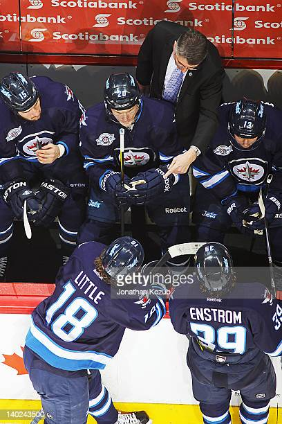 Head Coach Claude Noel of the Winnipeg Jets points at Bryan Little as he instructs his players at the bench during a first period stoppage in play...