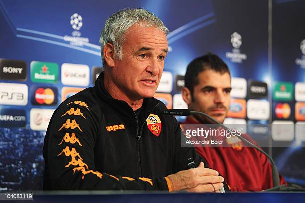Head coach Claudio Ranieri and midfielder Simone Perrotta of AS Roma answer journalists questions during a press conference ahead of the Champions...
