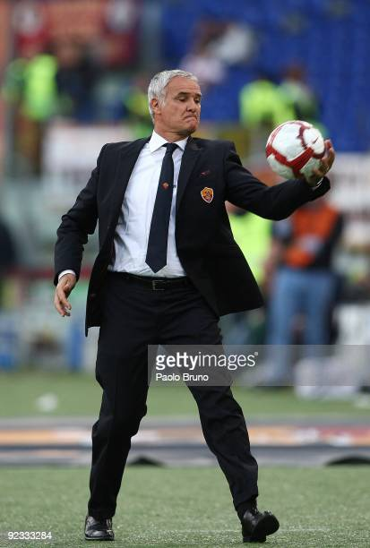 Head coach Claudio Ranieri of AS Roma catches the ball during the Serie A match between Roma and Livorno Calcio at Stadio Olimpico on October 25 2009...