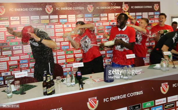 Head coach Claus Dieter Wollitz of Cottbus gets an beer and champagner shower after moving up into the third league after the Third League Playoff...