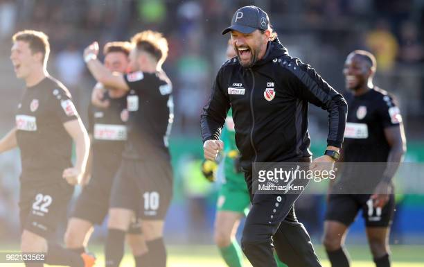 Head coach Claus Dieter Wollitz of Cottbus jubialtes after Maximilian Zimmer scoring the third goal during the Third League Playoff Leg 1 match...