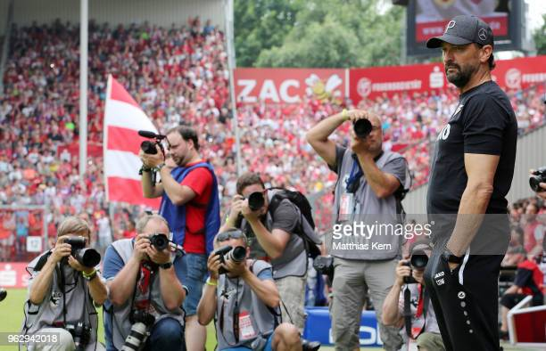 Head coach Claus Dieter Wollitz of Cottbus looks on prior to the Third League Playoff Leg 2 match between FC Energie Cottbus and SC Weiche Flensburg...